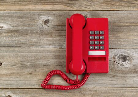 analogs: Vintage red phone on rustic wooden boards. High angled view. Stock Photo