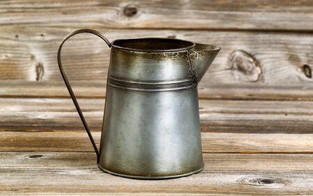 rustic  wood: Vintage metal coffee pot on rustic wood.