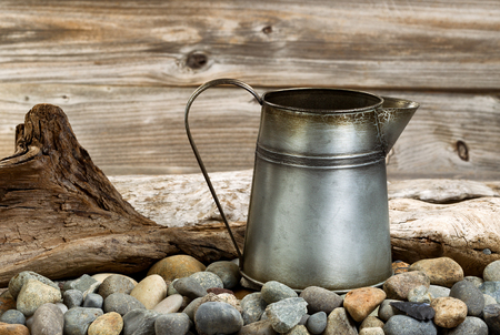 fire pit: Traditional metal coffee pot on fire pit made of stones and drift wood. Stock Photo