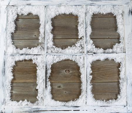 pane: Vintage six pane window, with powdered snow, on rustic wood. Stock Photo