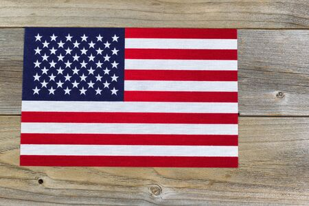 government services: United States of America flag on rustic cedar wood.