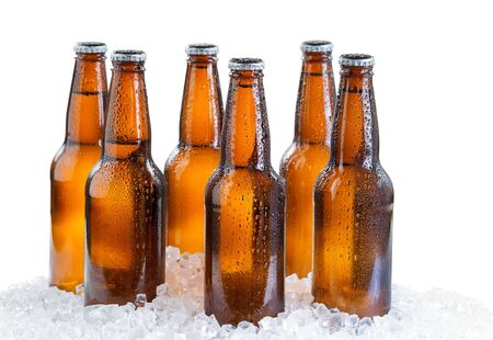 six pack: Six pack of bottled beer with drops and ice isolated on white background Stock Photo