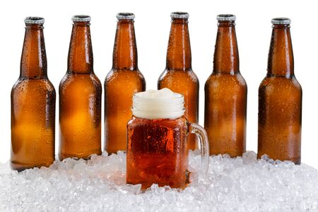six pack: Frosted mug of beer in front of a six pack of bottled beer with drops and ice isolated on white background