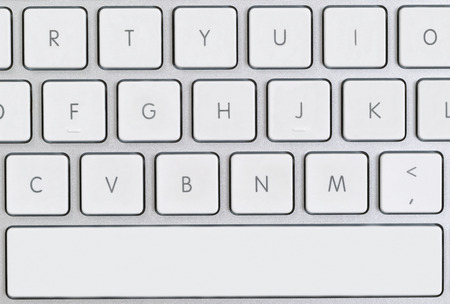 Close up of partial computer keyboard in filled frame layout.
