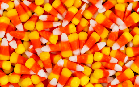 Filled frame of candy corn perfect for the Halloween holiday.