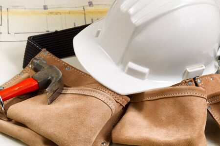 contractor: Close up of construction contractor tools with blurred out blue print drawings in background. Stock Photo