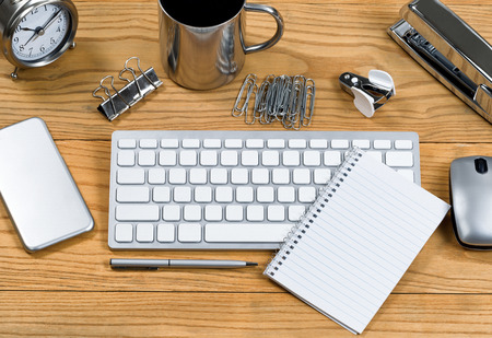 telecommute: Desktop with all silver color accessories.