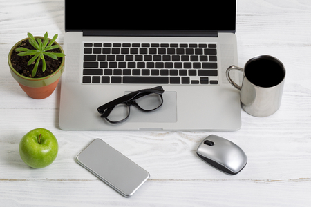 white work: Clean and organized white desktop with office work objects and snacks. Layout in horizontal format. Stock Photo