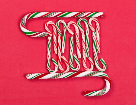 peppermint candy: Pattern of peppermint candy canes on red background. Stock Photo