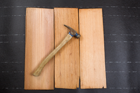 horizontal format: Used roofing hammer on new cedar shake shingles and felt paper in horizontal format.