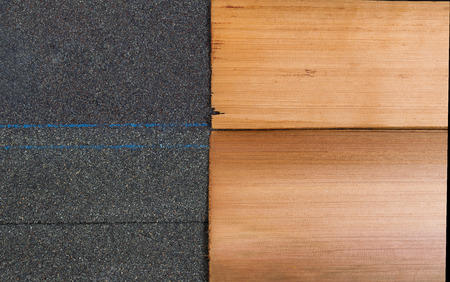 Side by side comparison of high quality new composite and cedar shake shingles in horizontal format.