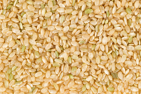 brown: Filled frame of organic raw brown rice in horizontal format. Stock Photo