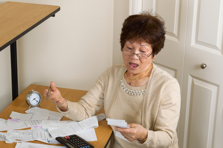 medical bill: Senior woman in shock of her financial bills. In debt concept.
