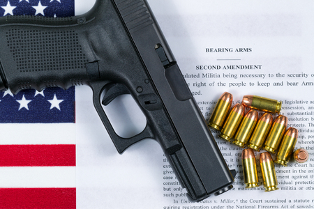 Pistol, bullets, USA flag and Text of second amendment for the right to bear arms.