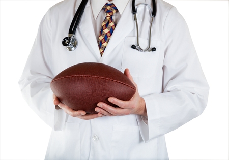 Close up front view of doctor holding football in hands on white background