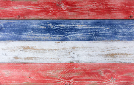 United States of America flag colors of red, white, blue on aging boards. Patriotic concept.