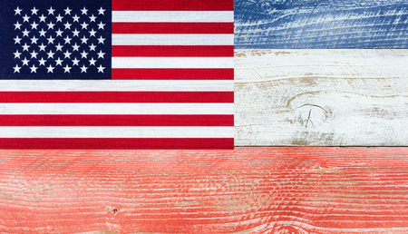 red america: Overhead view of United States of America flag, upper left hand corner, on wooden planks painted in national colors of red, white, blue. Patriotic concept. Stock Photo