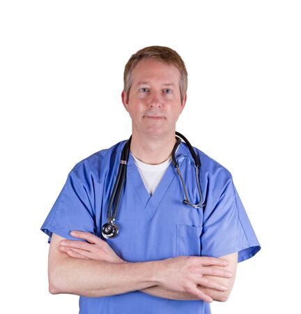 medical career: Doctor, looking forward, wearing blue medical scrubs with stethoscope on isolated white background. Stock Photo