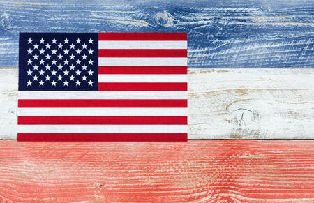red america: Overhead view of United States of America flag on wooden planks painted in national colors of red, white, blue. Patriotic concept. Stock Photo