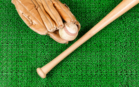 mitt: Overhead view of baseball mitt, ball and bat on artificial grass