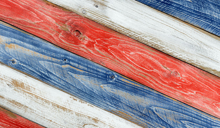 red america: Angled faded wooden boards painted red, white and blue for patriotic concept of United States of America.