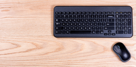Overhead view of a clean desk consisting of computer keyboard and mouse. Stock Photo