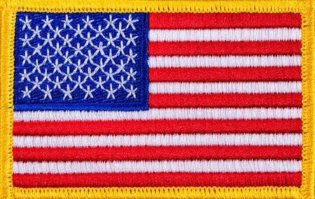 white flag: Close up USA flag with yellow trim in filled frame format.