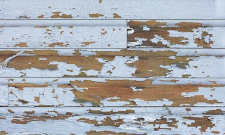 Cracking and peeling lead paint off of wood sliding. 版權商用圖片 - 56859020