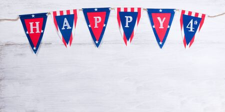 USA banner for happy Fourth of July holiday on rustic white wood. Stock Photo