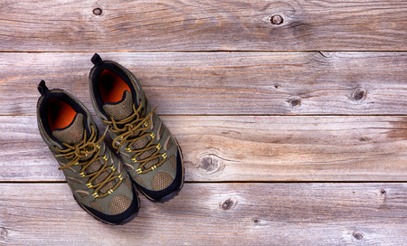 hiking shoes: Top view of new hiking shoes on rustic wooden boards Stock Photo