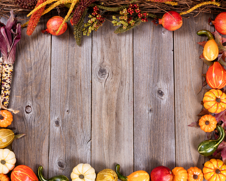 Overhead view of seasonal autumn gourd decorations, complete borders, on rustic wooden boards. Stock Photo