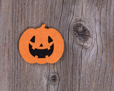 Bright pumpkin decoration on rustic wood