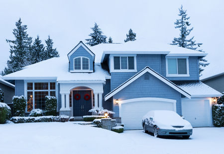 Fresh blanket of snow on residential home during the winter holidays.