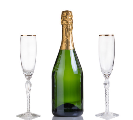 unopen: Champagne bottle with drinking glasses isolated on white with reflection