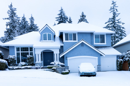 Home during winter snow season Foto de archivo