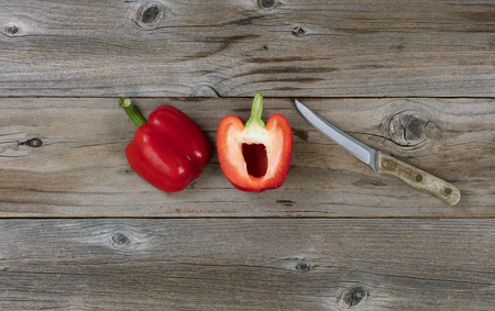 paring: Sliced bell pepper and paring knife on rustic wood in flat lay format