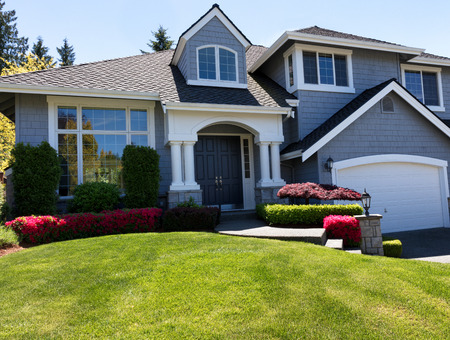 Front view of a well maintained front yard of home during a nice spring day