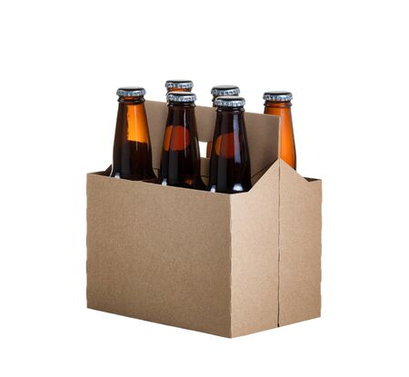Angled view of a six pack of glass bottled beer in generic brown cardboard carrier isolated on white background Фото со стока - 82101923