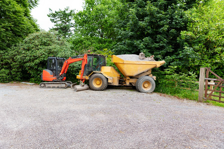 Construction equipment on job location with stone for road work Stock Photo