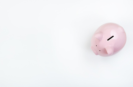 Piggy Bank on white desktop with copy space