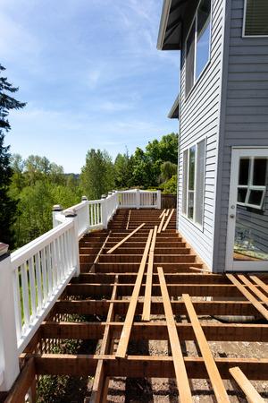 Aged outdoor wooden cedar deck tear down