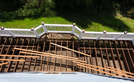 Overhead view of aged outdoor wooden cedar deck being tore down