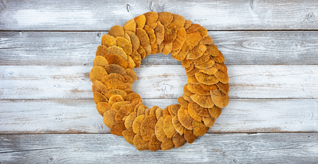 Wreath made of natural fungi or mushroom on white rustic wooden boards 스톡 콘텐츠