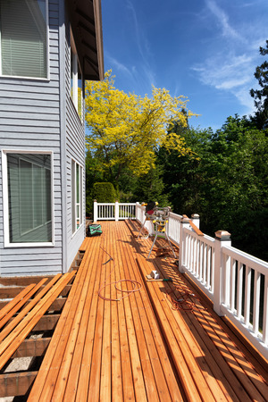 Outdoor wooden deck being completely remodeled during springtime season