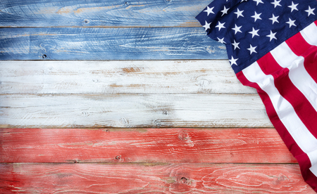 United States flag on red, white and blue rustic wooden boards with plenty of copy space