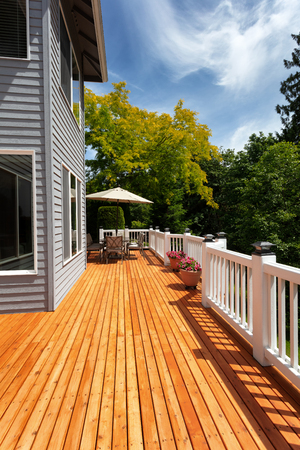 Brand new red cedar outdoor wooden deck during nice weather in vertical layout