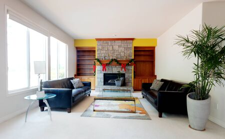 Modern living or family room decorated with Christmas objects on fireplace
