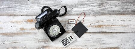 Vintage technology includes rotary dial phone and old data storage devices