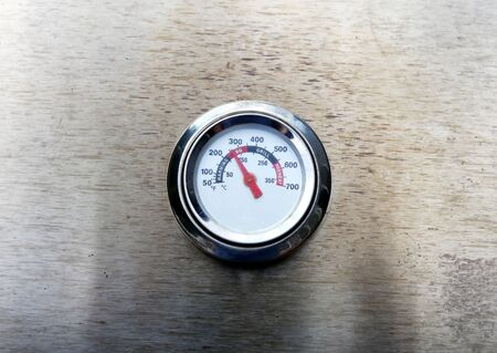 Temperature gage on barbecue cooker 스톡 콘텐츠