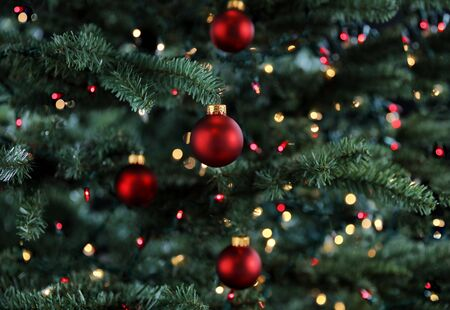 Glowing Christmas tree decorated with red ball ornaments 스톡 콘텐츠
